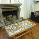 antique fireplace, ceramic shards table